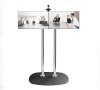 Includes VC shelf which can mount camera above or below the screens